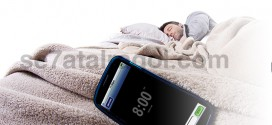 mobile beside a sleeping man